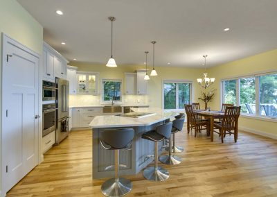 kitchen with quartz counter tops and dining rooms
