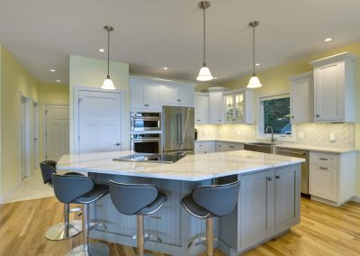 corner kitchen with island and stainless steel appliances