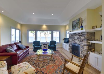 living room with fireplace, couches, and recliners