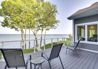 outdoor deck with view of water