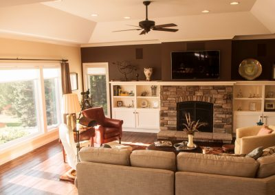 living room with brown sectional and fireplace