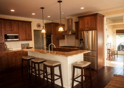 kitchen with island, stainless steel appliances, and brown cabinets