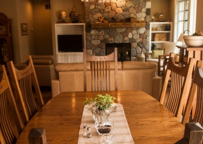 dining room with fireplace in the background